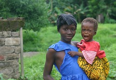 isatu and amadu (LindsayStark) Tags: africa travel portrait people girl children war sierraleone conflict humanrights humanitarian displaced idpcamp refugeecamp idps idp humanitarianaid emergencyrelief idpcamps waraffected