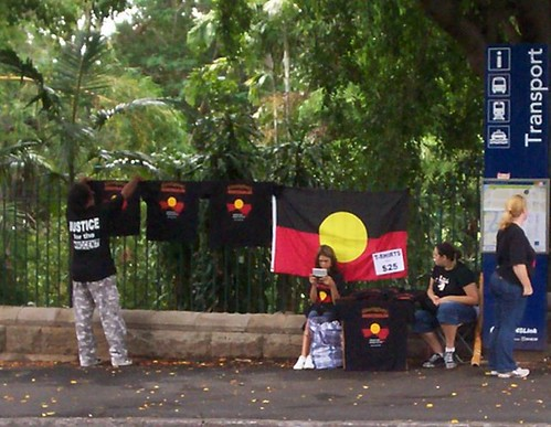 T-Shirt sellers on corner of George and Alice Sts, adjacent to Parliament House - Invasion Day rally, Brisbane, Queensland, Australia
