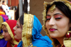 Punjaban (~FreeBirD~) Tags: travel ladies people india cute colors beauty smile wow eyes nikon women bravo asia faces d70 traditional mani shy charm jewellery females folkdance giggles polite 2007 mela surajkund babbar punjaban nikonstunninggallery lovemax manibabbar peopleflickr surajkund2007 httpbirdofpreyspaceslivecom httplamenblogspotcom