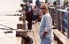 fisher (.sanden.) Tags: malibu canon film beach pier cigar sanden man sunglasses watch goatee public people fishing unitedstates us