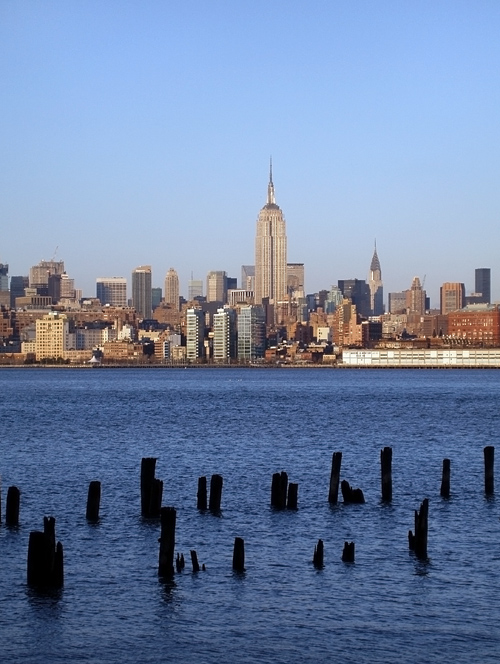 old NJ pier ruins with Empire State Building