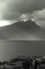 Garda lake after the storm (Mario De Carli) Tags: light bw panorama cloud white mountain lake storm black mountains castle film water rain clouds montagne 35mm lago lights garda nuvole nuvola view pentax bn luci tempest acqua pioggia castello montagna bianco nero luce torri temporale tempesta benaco mz5 pellicola ipl pizzoccolo