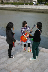 Band practicing in the Peace Park in Hiroshima, Japan (Mar 2007) (Cor Lems) Tags: music girl japan river japanese march spring asia punk peace guitar hiroshima rockmusic nippon japanesegirls japon japanesemusic atomicbomb 2007 abomb peacepark girlband canoneos500d japanesegirlband