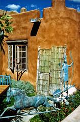 Yard Sale (Texas Finn) Tags: horse newmexico window aqua indian wroughtiron adobe bow arrow taos railing bowandarrow torquoise vigas