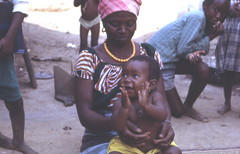 Grandmother and grandchild, Kabala, Sierra Leone (West Africa) (gbaku) Tags: pictures africa cute scarf children photo necklace 60s village child photos head expression african picture villages sierra photographs sierraleone photograph delight westafrica afrika 1960s anthropologie leone sixties anthropology amulet africain afrique ethnography ethnology africaine westafrican ethnologie afrikas