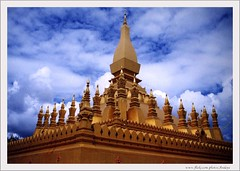 Sky Worship (Araleya) Tags: travel blue sky cloud film work temple golden interestingness intense buddhist religion feel holy monastery laos coolest atmospheric vientiene nikonfa abw blueribbonwinner awayfromhome budddhism thatluang araleya 10faves instantfave i500 interestingness307 aplusphoto frhwofavs laospdr tatluang