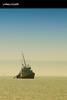 Lonely Boat (Hussain Shah.) Tags: sea port d50 boat nikon ship sigma lonely kuwait 70300mm doha الكويت ميناءالدوحة القاربالوحيد