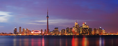 Urban Stillness Panorama (David Giral | davidgiralphoto.com) Tags: longexposure pink urban toronto ontario canada david reflection tower skyline night skyscraper cn landscape evening nikon long exposure cityscape cntower skyscrapers purple shot windy royalyork highrise d200 fairmont giral rogerscenter nikond200 splendiferous vle 18200mmf3556gvr instantfave abigfave copyrightdgiral davidgiral