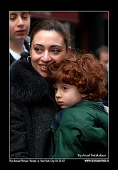 Mother and Son (Persians in Persian Parade 2007) (PureMomentStudio By Arash) Tags: 032507 the annual persian parade new york city year norooz iran iranian flag red wight nikon nikkor d200 arash behshadpoor 1386 girl face portrate color son mother love side eyes hair