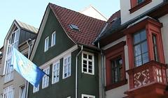 Three generations of houses (:Linda:) Tags: roof house window germany bavaria fenster flag franconia halftimbered drei dachrinne erker downpipe baywindow flagholder buildingdecoration geschrieben geschriebenes