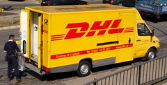 DHL at work ... (bayernernst) Tags: 2007 europa deutschland germany auto autos cars spotting carspotting spotter lieferwagen van deliveryvan deliveryvans europeanvans mercedesbenz mercedesbenzsprinter sprinter dhl europe photographie fotografie photography schnappschus snapshot transport transportation transportmethods werbung reklame advertising publicité advert dhlworldwide kontrast rot