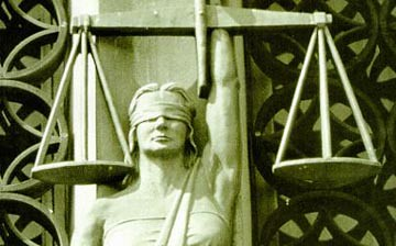 Lady Justice (Photo: vaxzine, flickr)