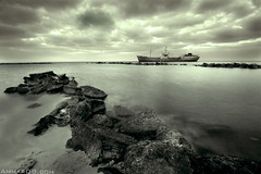 Between Sea and Sky (Ammar Alothman) Tags: sea sky blackandwhite bw seascape beach canon flickr gulf kuwait ammar 1022 kuwaitcity kw doha 2007 q8 30d  canon1022 canon30d  outsta