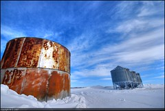 Survival of the Fittest (A guy with A camera) Tags: new old winter sky snow canada cold field clouds rural nikon rust flickr farm steel wheat country grain rusty sigma canadian farmland storage alberta crop silos prairie agriculture 1020 bins hdr storehouse granary farmstead granaries abphotobloggers d80 isawyoufirst