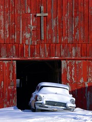 Car and the Cross (jmurphpix) Tags: wood red snow car barn rural buick flickr cross decay country religion philosophy iowa panasonic explore faded weathered peelingpaint oldwood dmcfz30 joemurphy josephlmurphy jmurphpix
