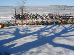 Terrace in March (Ann Althouse) Tags: lake ice wisconsin frozen shadows chairs madison frozenlake memorialterrace