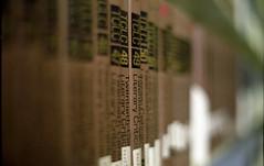 48 49 (bcostin) Tags: film dof bokeh f14 library books bookshelf scan negative konica shallow fuji200 t2 autoreflext coolscanved hexanon57mmf14 tclc twentiethcenturyliterarycriticism
