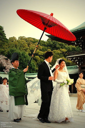 happiest moment A wedding couple march their way to the altar inside the Meiji-Jingu Shrine.