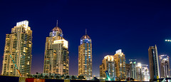 sky scraping at night (d5e) Tags: longexposure blue light sky urban orange night marina dark lights dubai glow shine availablelight metropolitan emaar d40