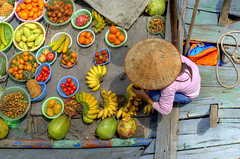 Halong Bay fruit seller - by Andrew Hux