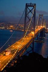 Sunset over San Francisco (Ar'alani) Tags: sanfrancisco travel bridge sunset clouds lights evening cityscape treasureisland baybridge globalvillage globalcity invitedphotosonly gvadminshalloffame itsabeautifulgv