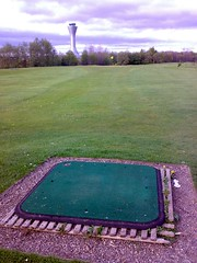 Hole looking toward airport tower at Port Royal Golf Driving Range, Edinburgh