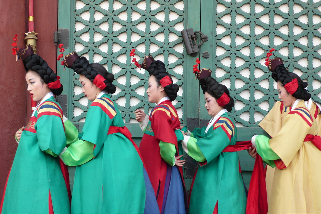 Dancers in Korean traditional dress preparing to go on stage