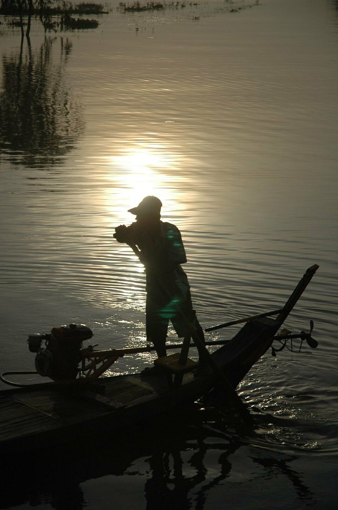 Early morning boatman at Takeo