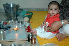 Another one doing pooja... (cheechpuchi) Tags: babies pooja kashmiri rushaan shivratri hearath