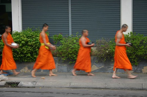 Monk novices collecting food in the streets of Chiang Rai
