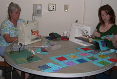 Ellena and Krista working on a charity quilt