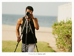 What Can I Do? (Nasser Bouhadoud) Tags: camera canon myself 350d mirror do looking tripod taken running can what nasser qatar quiksilver saher  allil