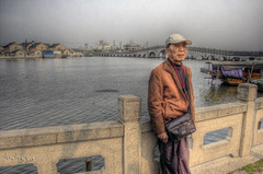 YEYE AND THE LAKE (@yakobusan Jakob Montrasio ) Tags: china trip travel vacation lake 3 water photoshop town spring day view shanghai cloudy april mission shanghaiist hdr 8th province jiangsu yeye zhouzhuang 2007 impossible photomatix