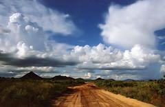 Northern kenyan landscape for celtic eyes (Délirante bestiole [la poésie des goupils]) Tags: africa road clouds landscape kenya wideangle afrique samburunationalpark northernkenya abigfave anawesomeshot