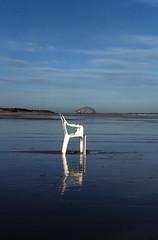 Chair2 (Sandy Beach Cat) Tags: sea reflection beach rock found scotland sand chair bass flotsam lothian tynninghamme