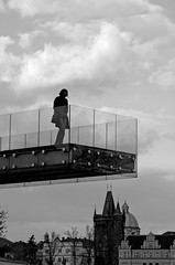 Woman on suspended bridge