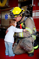 this one, well it kills me... (sesame ellis) Tags: family girl kid hug toddler kiss child sweet mykid fireman mybrother year3 racheldevine wwwracheldevinecom