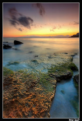 capsalou3 (Aitor Escauriaza) Tags: longexposure sky beach water clouds d50 mar nikon searchthebest stones playa arena cielo nubes reus salou piedras costadorada sigma1020 seasand aitorescauriaza