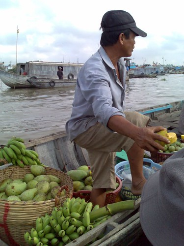 Selling fruit at Cai Rang Floating Market