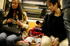 Photo of kid on subway, New York City