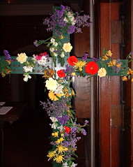 cross with holes for flowers before Easter services