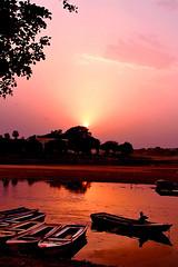 Ravi Kinaray (Naeem Rashid) Tags: pakistan sunset colors silhouette d50 river boats boat nikon colorful dusk sunsets ravi punjab lahore superaplus aplusphoto