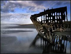 shipwreck at sunrise (jody9) Tags: beach topf25 oregon sunrise pacific shipwreck astoria peteriredale thebestbravo abigfave artlibre