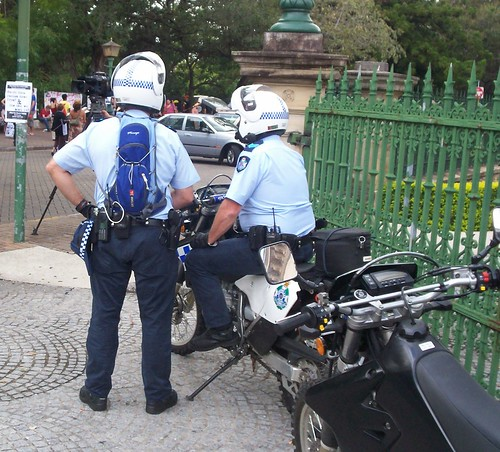 Police dirt bikes outside corner gate of Parliament House, Cnr George and Alice Sts - Invasion Day rally, Brisbane, Queensland, Australia-13