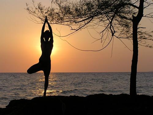 Wallpaper showing a yogi practising Sun Yoga at sunset