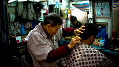 traditional haircut in the alley - by charles chan *