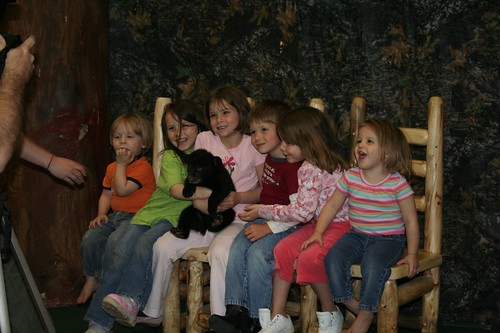 Kids holding bear cub