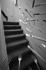 the downside of a magnetic personality (Orrin) Tags: blackandwhite utensils stairs flying lenstagged dangerous pointy silverware stairway knives forks