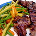 Lamb chops with string beans, wax beans, and carrots