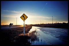 (scottintheway) Tags: road blue sunset sky bike sign yellow plane landscape spring highway angle wide jet trail saskatoon arrow saskatchewan magichour